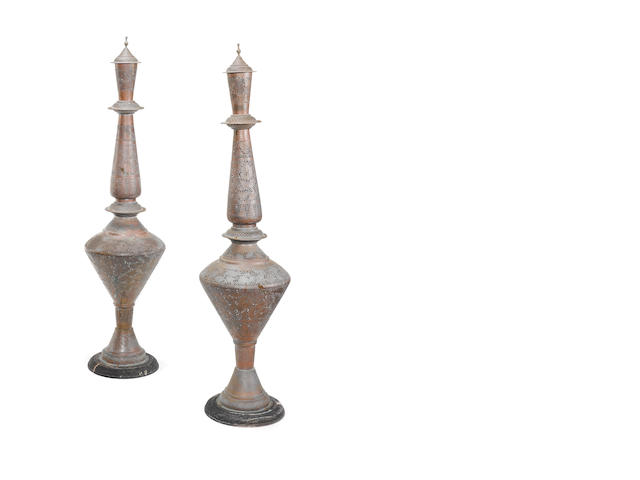A pair of Indian late 19th/ early 20th century pierced bronze lamps