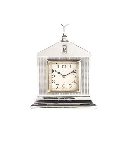 A fine and rare Rolls-Royce sterling silver presentation deskpiece clock, by Saunders & Shepherd, London, 1927,