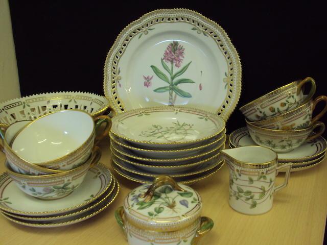 A Royal Copenhagen floral painted part tea service and basket