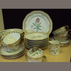 A Royal Copenhagen floral painted part tea service and basket