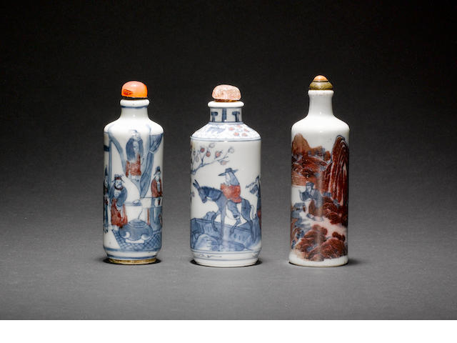 Three Chinese snuff bottles of cylindrical form; all with a stopper One bottle with Yongzheng mark