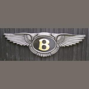 A cold-cast aluminium Bentley badge,