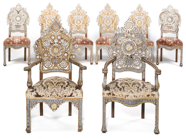 A set of eight Damascus late 19th century teak, bone and mother of pearl inlaid dining chairs