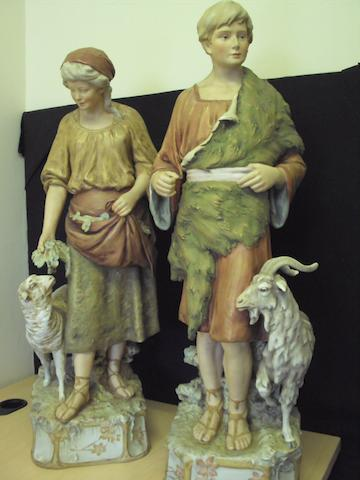 A pair of large Royal Dux figures of shepherd and shepherdess