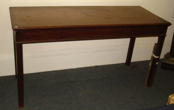 A George III style mahogany serving table, 19th Century and later, the moulded rectangular top above a plain frieze, on square chamfered legs, 153cm.