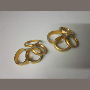 A collection of eight 22 carat gold wedding bands,