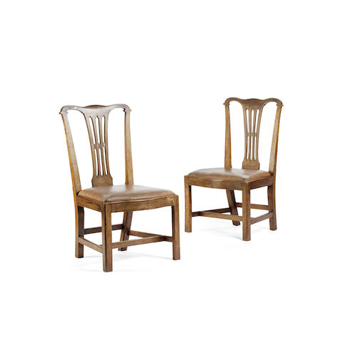 A set of six early 20th century walnut dining chairs In the manner of Sir Robert Lorimer