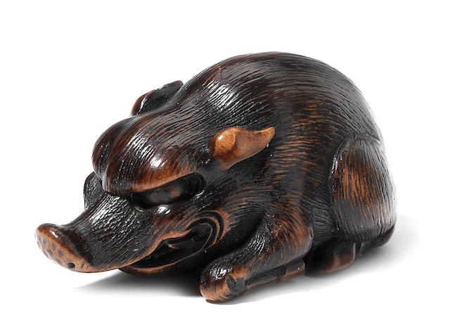 A wood netsuke of a recumbent wild boar By Yasusada Shuzan, 19th century