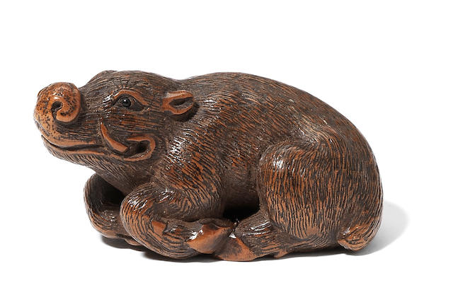 A wood netsuke of a wild boar By Kokei, circa 1820