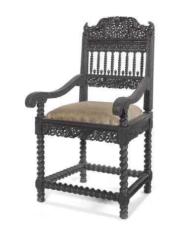 An Indian 17th century carved ebony armchair