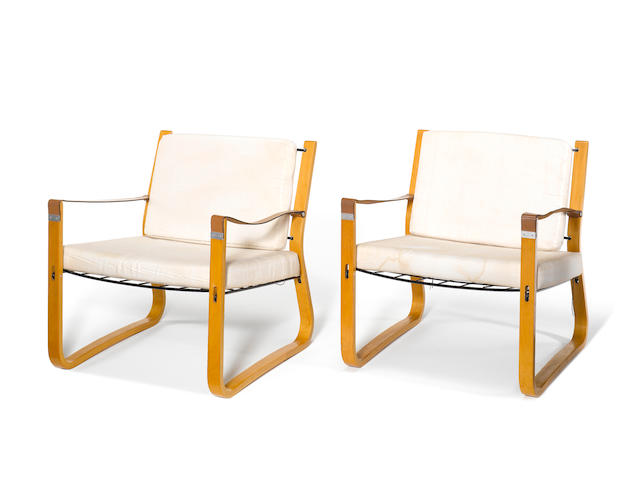 Nicholas Frewing for Race Furniture Ltd A Pair of Chairs circa 1948  with beech faced plywood frames, sling leather arms and enamelled mesh seats traces of stamped mark to underside of arms Height: 67.5 cm. 26 9/16 in.