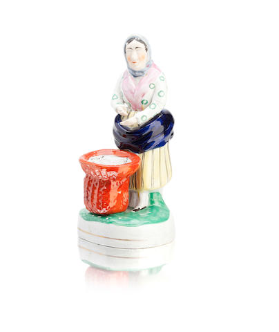 A Scottish east coast pottery figure of a fishwife Circa 1820