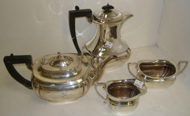 A four piece silver tea service, of cushion shape comprising: teapot, hot water jug, milk jug and sugar basin by Edwin Viner, tea set Sheffield 1939, hot water jug 1936, 62ozs gross.