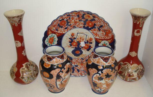 A pair of Fukugowa Imari decorated vases, painted in typical colours with maple leaves, 19cm, a pair of Satsuma bottle vases painted with panels of figures on an ironstone ground, 30cm, and a Japanese Imari charger, 31cm diameter (5)
