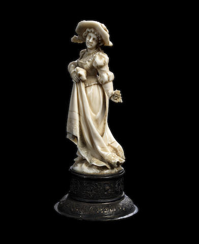 An ivory figure of a lady in 18th Century style dress, on a silver plinth - 12cm high