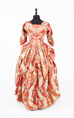 A 1770-80s silk brocade polonaise dress and a quilted silk petticoat