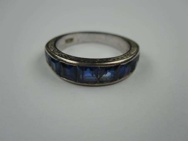 A sapphire half-hoop eternity ring