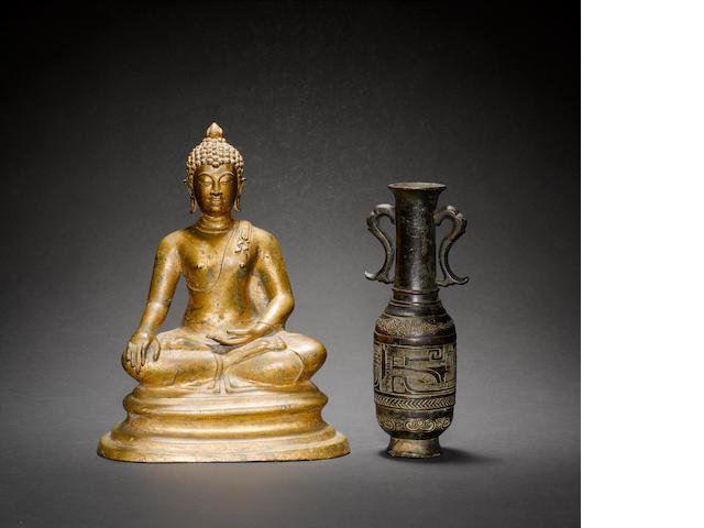 A gilt figure of a Buddhist Deity, probably Sakyamuni The Historical Buddha, seated in dhyanasana