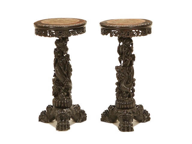 A pair of South East Asian late 19th Century carved hardwood jardiniere stands