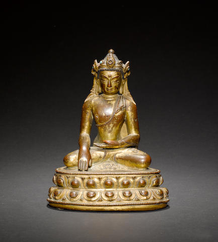 A small gilt-bronze figure of a Buddhist Deity, possibly Maitreya