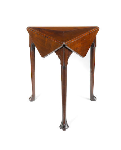 A George III Irish mahogany swivel top envelope card table