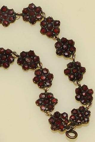 A garnet multi cluster necklace and brooch, a Danish white enamel suite and a teddy bear brooch (6)