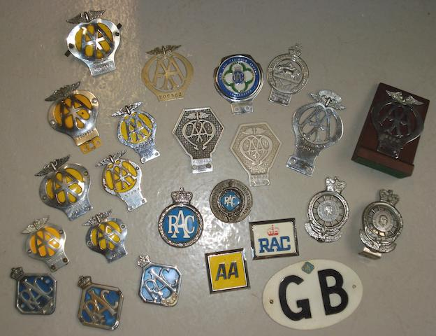 A collection of motoring badges,