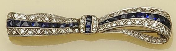An early 20th century sapphire and diamond brooch