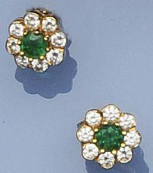 A pair of emerald and diamond cluster earstuds, by Boodle and Dunthorne