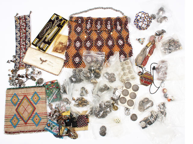 A group of buttons and beadwork items
