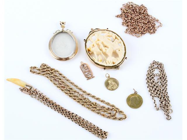 A precious yellow metal ivory brooch (10)