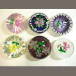 A collection of Peter Holmes flower paperweights Including limited edition examples