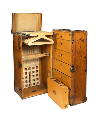 A large and impressive leather-cased wardrobe trunk by Louis Vuitton, 1920s measuring 44 1/2 x 27 x 22 inches overall