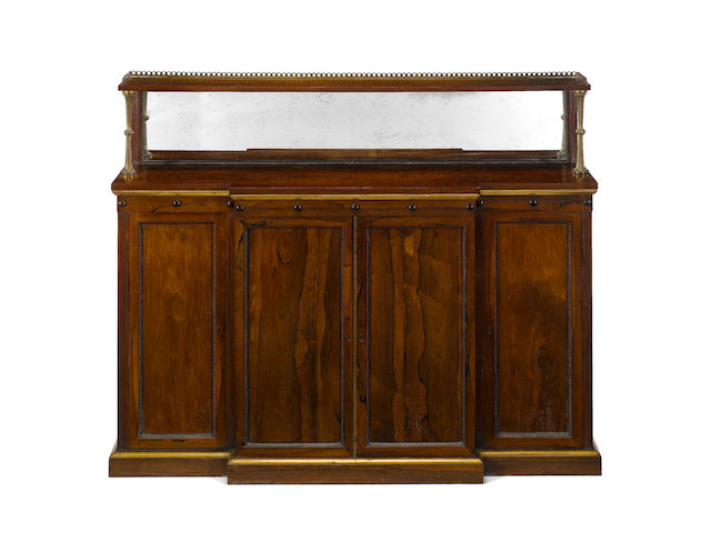 A Regency rosewood and parcel gilt breakfront chiffonier