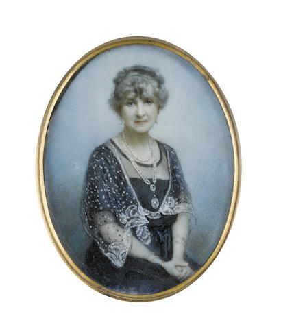 Attributed to Mabel Lee Hankey (British, 1863-1943) A Lady, seated and wearing navy blue dress and sheer fill-in, white lace shawl, both of her wrists bearing gold and silver bracelets, her hands clasped in her lap, an oval locket on a white ribbon suspended from her neck, pearl necklace and pendent earrings