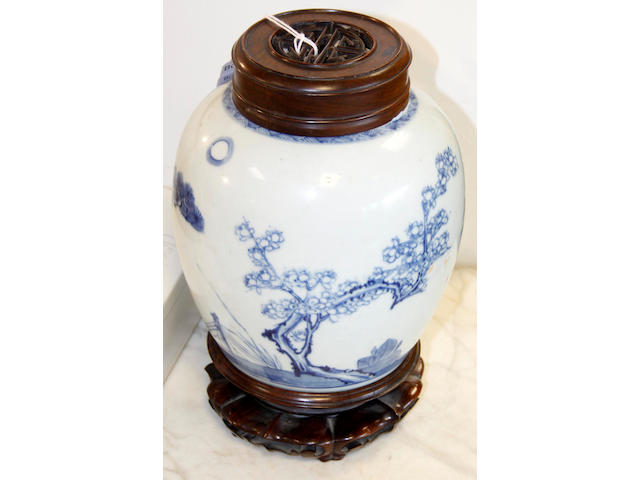 Two Chinese blue and white baluster jars with wooden covers