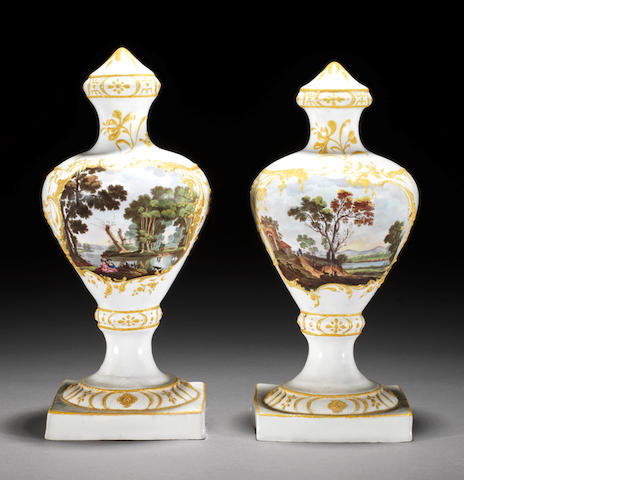 Pair of urn shaped vases (some restoration)
