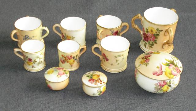 Seven miniature Royal Worcester blush ivory mugs and tygs; together with three lidded circular boxes,