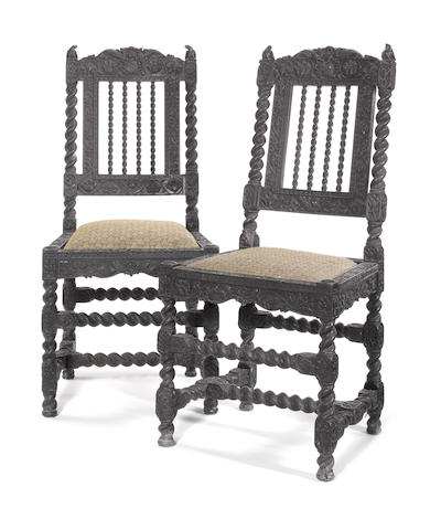 A pair of Coromandel Coast second half 17th century carved ebony side chairs