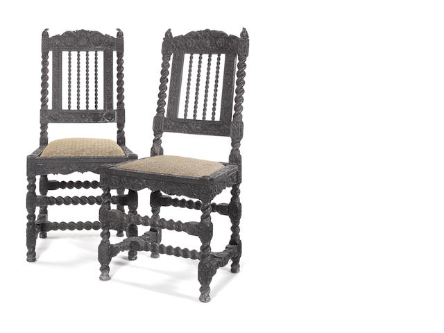 A pair of Indian 17th century carved ebony side chairs