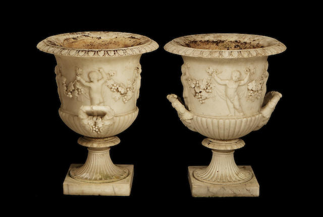 A pair of late 19th century Carrara marble urns