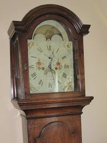 An early 19th century oak cased eight day long case clock M. Abraham
