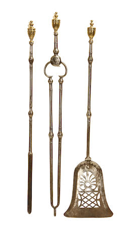 A set of Regency steel and brass fire tools