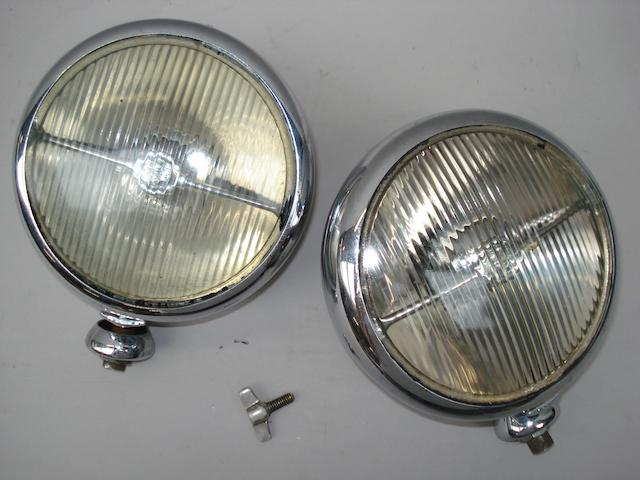A matching pair of original 1930s Lucas pass lamps
