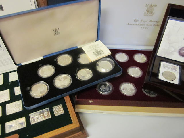 Commerative coins and Stamp replicas: (4 cased sets.)