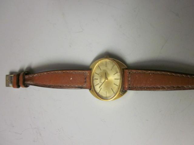 An 18 carat gold lady's Bulova Accutron strap watch,