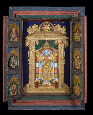 A large mid-19th century hanging temple cabinet, the interior depicting Vishnu within an ornate alcove in relief, Tanjore, South India