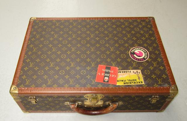 A Louis Vuitton suitcase,
