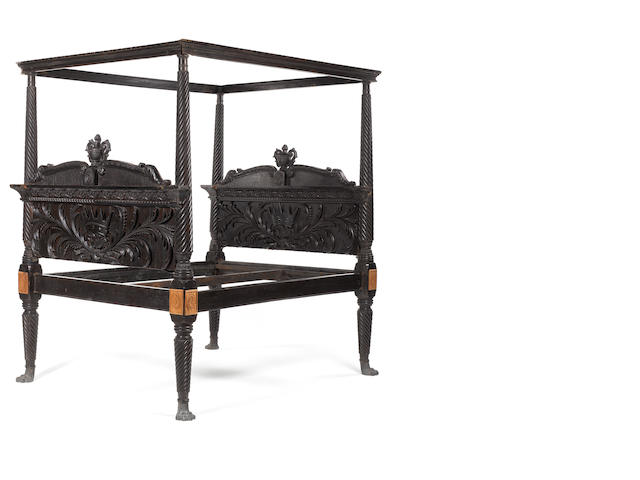A large Anglo-Indian mid 19th century carved ebony four poster bed