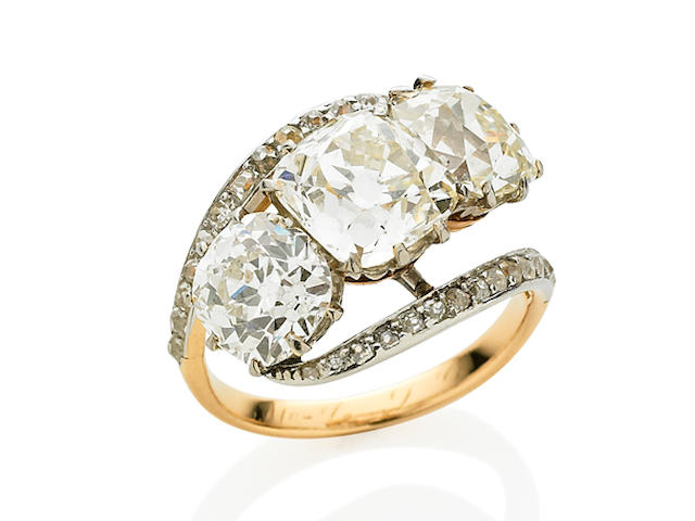 An Edwardian three stone diamond ring